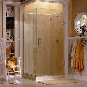 View of a bathroom, cream walls, glass shower bathroom, door, floor, flooring, interior design, plumbing fixture, room, shower, shower door, brown, gray