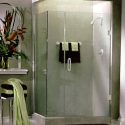 View of a bathroom, glass shower enclosure, white bathroom, floor, glass, interior design, plumbing fixture, shower, gray, brown
