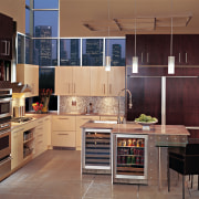 View of a kitchen, brown tiled floors, brown cabinetry, countertop, cuisine classique, interior design, kitchen, room, black, brown