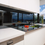 view of the kitchen area showing the stianless countertop, house, interior design, kitchen, property, real estate, window, white