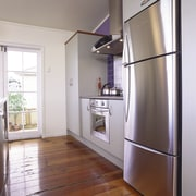Kitchen with light grey cabinetry, three door stainless door, floor, home, home appliance, interior design, kitchen, real estate, room, gray