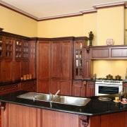 view of the black assoluto granite benchtop - cabinetry, countertop, cuisine classique, hardwood, interior design, kitchen, real estate, room, red, orange