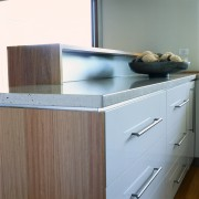 view of kitchen timber cabinetry and stainless steel bathroom accessory, cabinetry, chest of drawers, countertop, drawer, furniture, home appliance, kitchen, kitchen stove, sink, wood, wood stain, gray