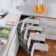 A view of a kitchen area, wooden flooring, drawer, furniture, kitchen, product design, shelf, shelving, table, gray