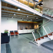 Vie wof the reception area, concrete flooring with architecture, daylighting, floor, handrail, lobby, real estate, stairs, gray