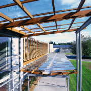 View of the building from up in the daylighting, outdoor structure, pergola, real estate, roof, structure