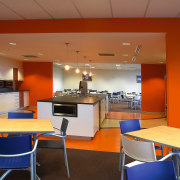 View of the workstations, orange walls, wooden desks architecture, café, cafeteria, ceiling, furniture, interior design, office, real estate, restaurant, table, brown, red