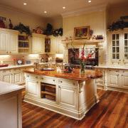 View of a kitchen, wooden flooring, wooden island cabinetry, countertop, cuisine classique, floor, flooring, hardwood, interior design, kitchen, room, wood flooring, brown, orange