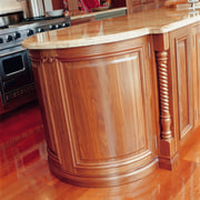 view of the custom designed timber kitchen cabinetry cabinetry, chest of drawers, countertop, cupboard, desk, drawer, floor, flooring, furniture, hardwood, kitchen, laminate flooring, sideboard, table, wood, wood flooring, wood stain, red, orange