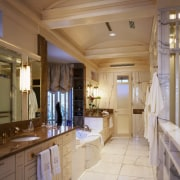 View of the bathroom, tiled floor, wooden cabinetry, ceiling, countertop, estate, interior design, room, brown, gray