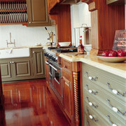 view of this kitchen area showing polished flooring cabinetry, countertop, cuisine classique, floor, flooring, hardwood, interior design, kitchen, room, wood, wood flooring, red