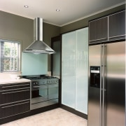 view of the kitchen and rangehood - view cabinetry, countertop, home appliance, interior design, kitchen, real estate, room, gray, black