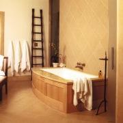 View of a bathroom, brown tiled flooring nd bathroom, floor, flooring, furniture, interior design, room, orange