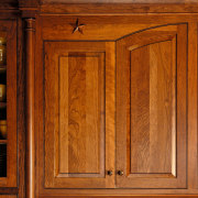 Close up view of some wooden cabinetry. - cabinetry, cupboard, door, furniture, hardwood, wood, wood stain, brown