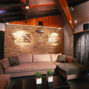 view of this lounge area with mounted wall ceiling, furniture, interior design, lighting, living room, lobby, room, wall, black