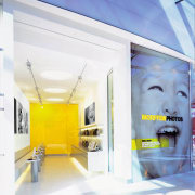 View of a showroom, many photos, many laptops ceiling, interior design, product design, wall, yellow, white