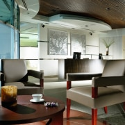 view of the quest waiting area showing dark ceiling, furniture, interior design, table, black