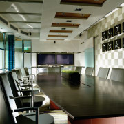 view of the formal boardroom which includes leather ceiling, conference hall, furniture, interior design, lobby, table, gray, brown