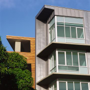 view of the apartments metal sheet cladding - architecture, building, commercial building, condominium, daylighting, elevation, facade, home, house, real estate, residential area, siding, window, gray