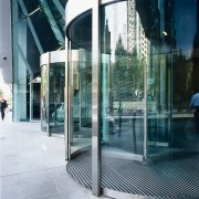 view of the glass revolving doors - view architecture, building, condominium, door, facade, glass, reflection, structure, window, white, teal, black