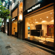 A exterior view of the Sony Gallery, large night, black, brown