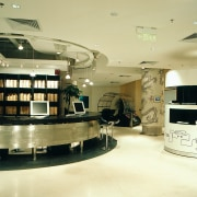 A view of the visitor information desk in ceiling, furniture, interior design, lobby, yellow