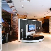 A view of a home theatre dispaly in ceiling, interior design, lobby, white