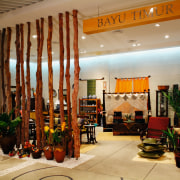 View of a store with a wall made interior design, lobby, brown, orange