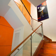 view of the stairway with orange wall softened angle, architecture, ceiling, daylighting, design, glass, handrail, house, interior design, product design, stairs, wall, wood, gray, brown