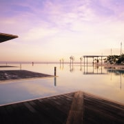 A view of the timber walkways surrounding the calm, cloud, condominium, dawn, dock, dusk, evening, horizon, morning, ocean, pier, real estate, reflection, sea, sky, sunlight, sunrise, sunset, vacation, water, white