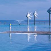 A view of the esplanade lagoon area, 4 calm, coastal and oceanic landforms, energy, ocean, sea, shore, sky, vacation, water, wave, wind, wind farm, wind turbine, teal