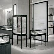 fine jewellery is display like treasure in museum display case, floor, furniture, glass, interior design, table, gray