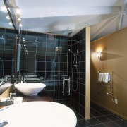 A view of a bathroom, black tiled floor architecture, bathroom, interior design, room, black, gray