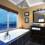 A view of a bathroom, black tiled floor bathroom, estate, home, interior design, property, real estate, room, window, black