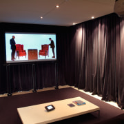 view of the home theatre area with motorised ceiling, interior design, room, black