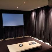 view of the home theatre area with motorised auditorium, ceiling, conference hall, display device, interior design, lighting, projection screen, room, black
