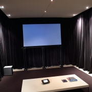 view of the home theatre area with motorised ceiling, interior design, light, light fixture, lighting, recreation room, room, table, black