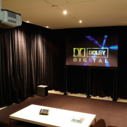 view of the home theatre area with motorised electronic device, interior design, room, black, brown