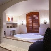 view of the bath tub area  with bathroom, bathtub, estate, floor, interior design, room, suite, gray
