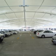 view of the all weather membrane car park airport terminal, building, car, hangar, luxury vehicle, motor vehicle, parking, parking lot, structure, gray