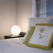 view of the ascot light fitting providing an bed, bed frame, bed sheet, bedding, bedroom, cushion, duvet cover, floor, furniture, home, interior design, linens, mattress, pillow, room, textile, wall, gray