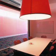 view of the redpod lighting fixture used in architecture, ceiling, daylighting, floor, interior design, lamp, lampshade, light, light fixture, lighting, lighting accessory, orange, product design, red, table, wall, red