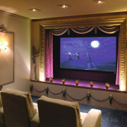 view of the custom designed home theatre and entertainment, interior design, lighting, room, brown