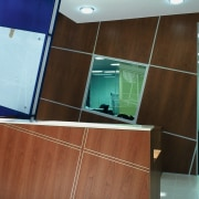 view of the reception area  with a floor, flooring, furniture, glass, interior design, brown