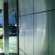 view of the polished stainless steel panels at architecture, glass, shade, window, gray