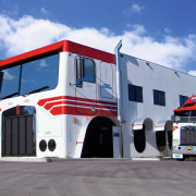 view of the depot of wickham freightlines  automotive exterior, commercial vehicle, emergency vehicle, fire apparatus, fire department, fire station, freight transport, mode of transport, motor vehicle, public utility, trailer truck, transport, truck, vehicle, gray, blue