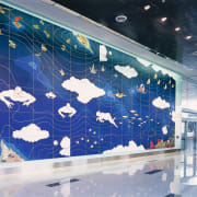 view of the foyer with giant sea mural space, technology, blue