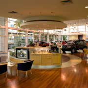 view ofe circular reception with adjacent showroom and cafeteria, interior design, lobby, retail, shopping mall, brown