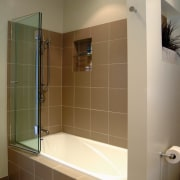 A view of a bath and shower in bathroom, floor, flooring, glass, interior design, plumbing fixture, room, tile, wall, brown
