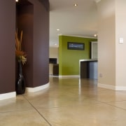 A view of a hallway, large cream concrete apartment, floor, flooring, hardwood, interior design, laminate flooring, lobby, real estate, tile, wood, wood flooring, gray, orange
